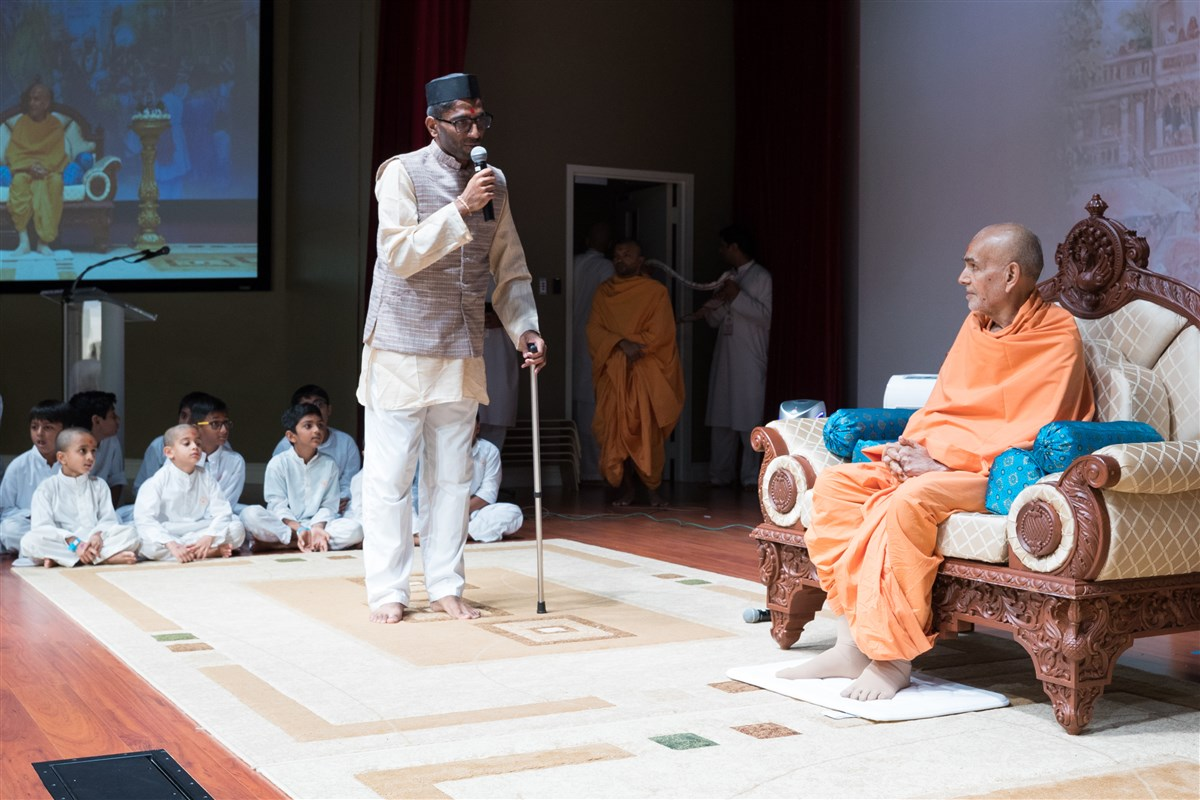 A youth performs a skit before Swamishri