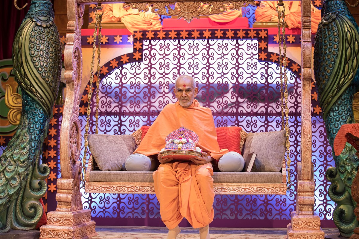 Swamishri with Shri Harikrishna Maharaj on a swing, 23 August 2017