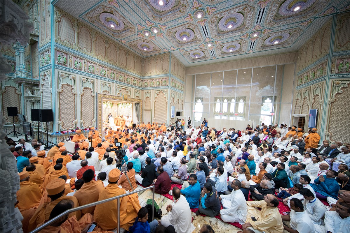 Devotees engaged in the assembly