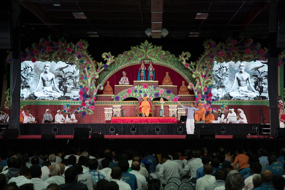 Devotees perform a skit before Swamishri