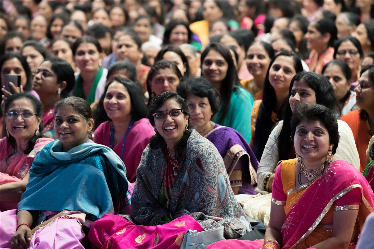 Audience views a video uniting three generations of women through Satsang and Samjan
