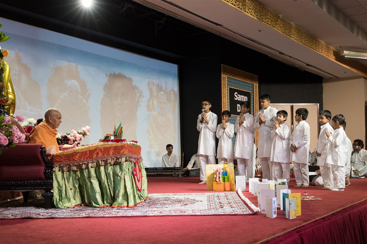 Children recite shlokas during puja