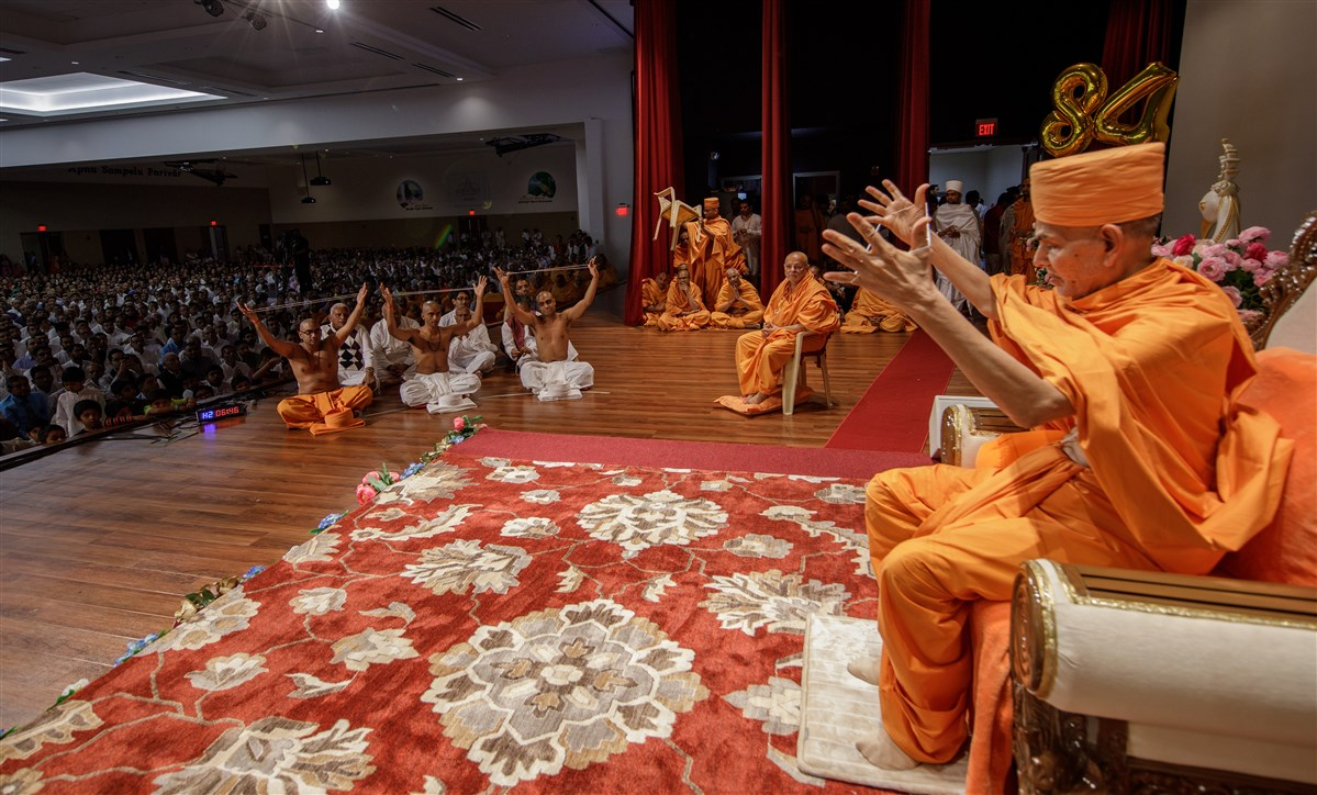 Swamishri and three youths engaged in diksha ceremony