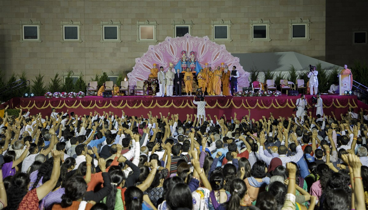 Swamis and devotees engaged in jaynad on this historical event