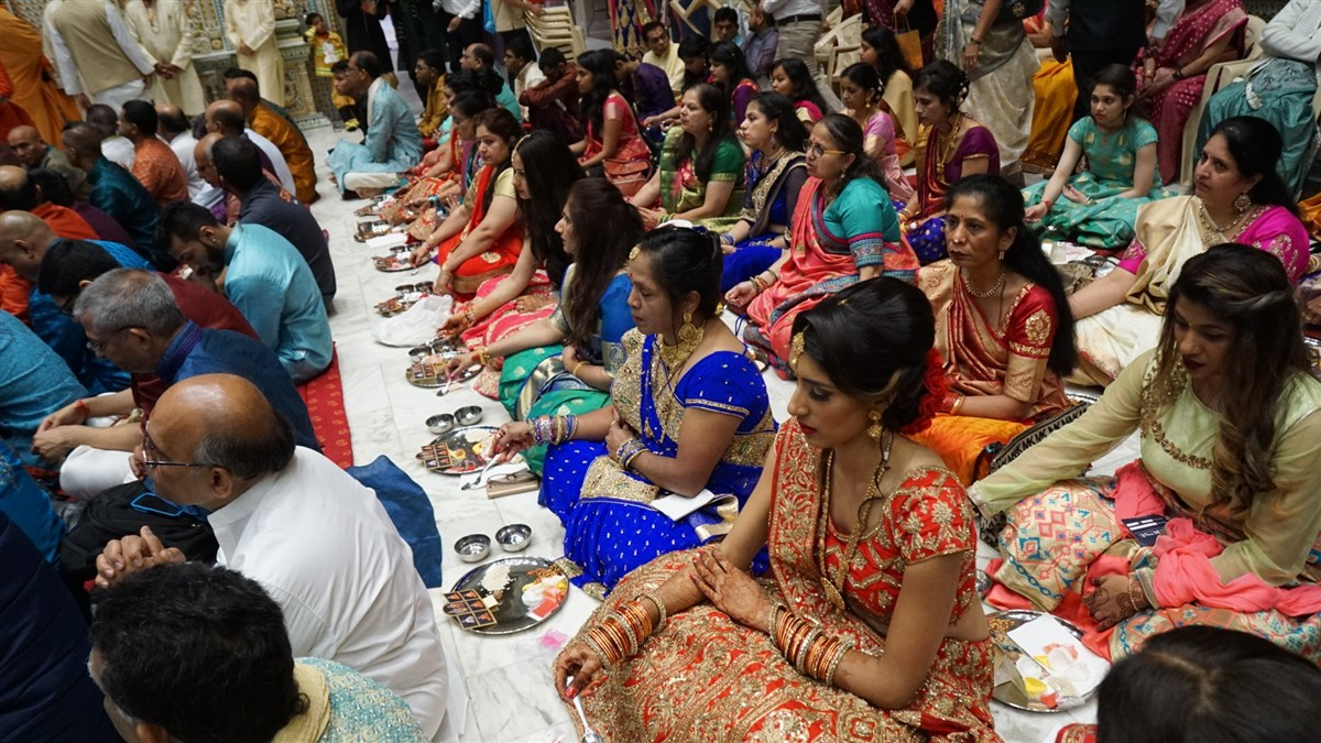 Devotees engaged in mahapuja rituals