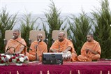Swamis perform kirtans to commence the assembly