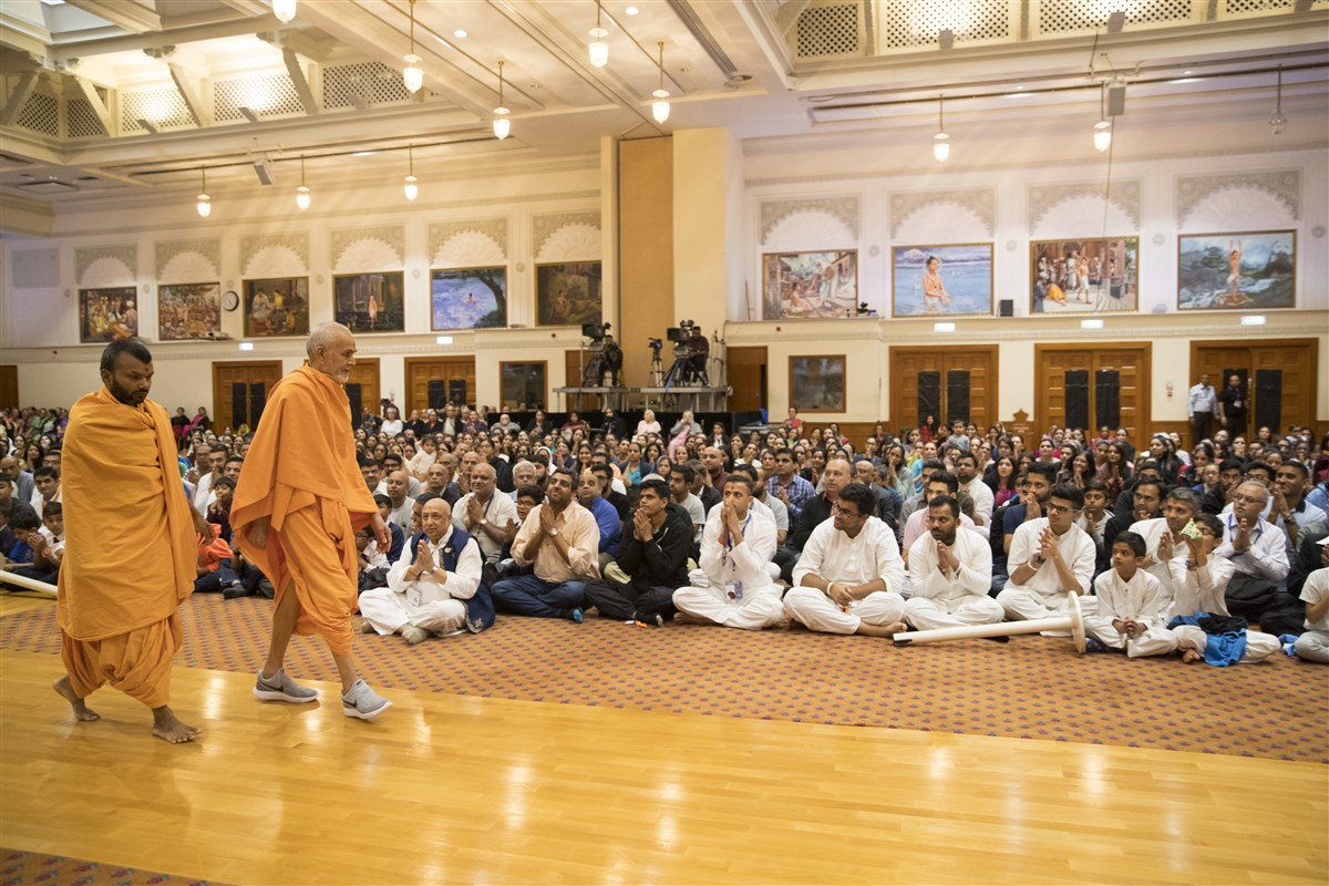 Swamishri performs his afternoon walk in the assembly hall