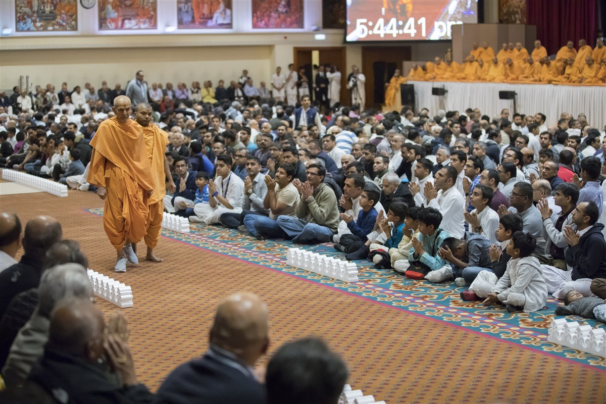 Swamishri performs his evening walk in the assembly hall