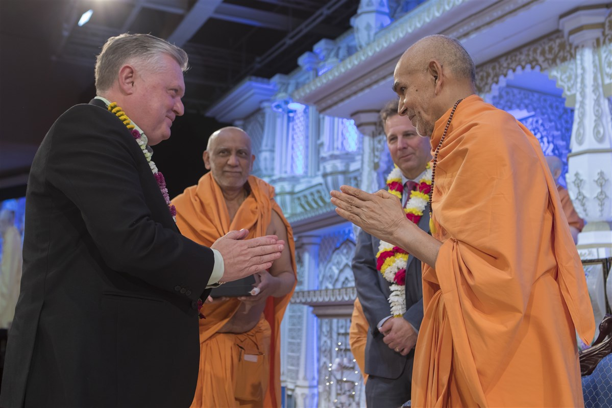 Swamishri greets officials from Queens Park Rangers Football Club