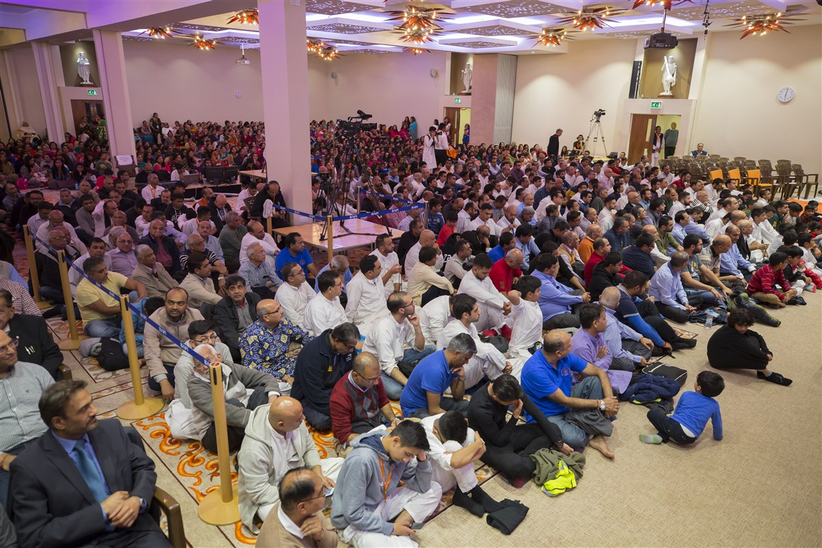 Devotees gather in the evening assembly