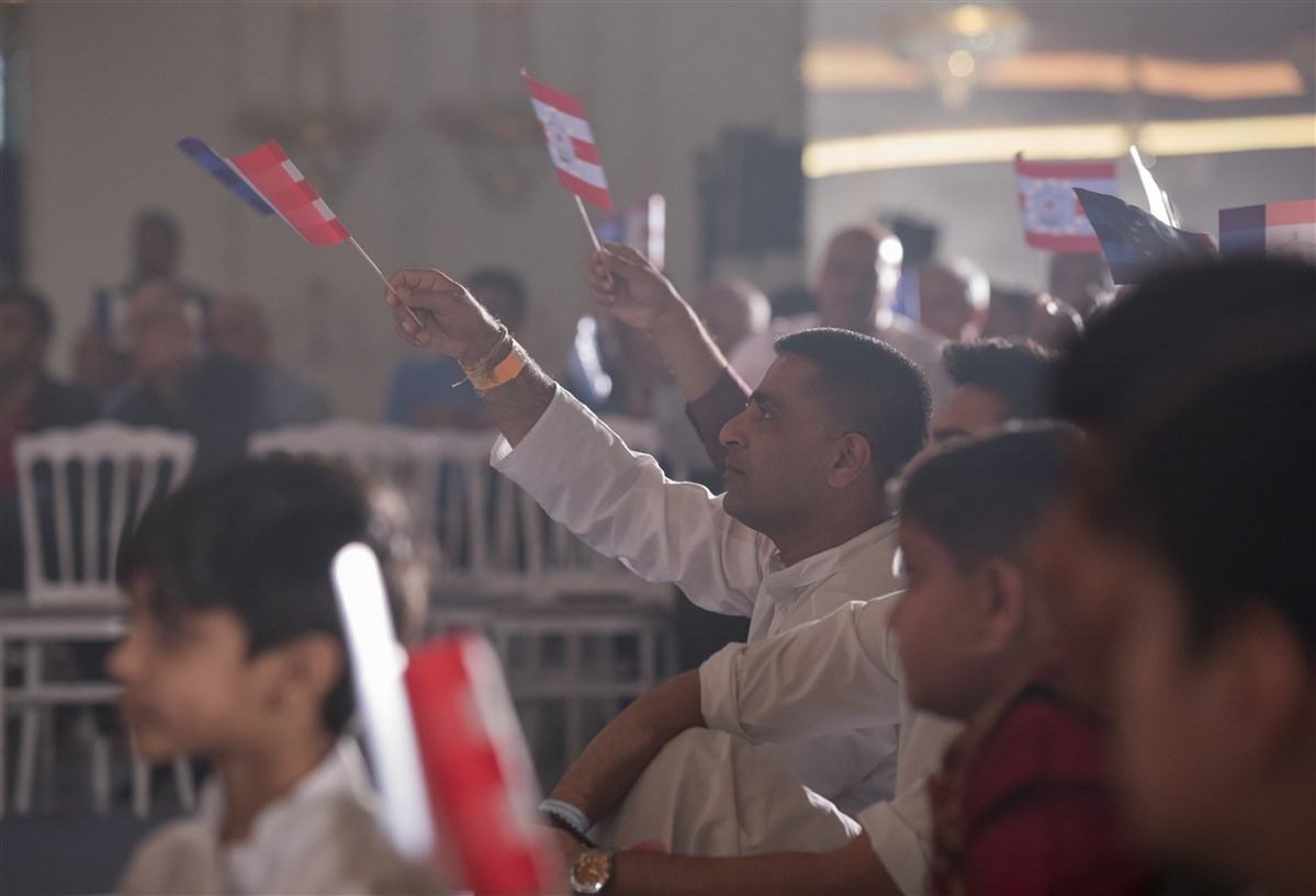 Devotees wave flags in celebration