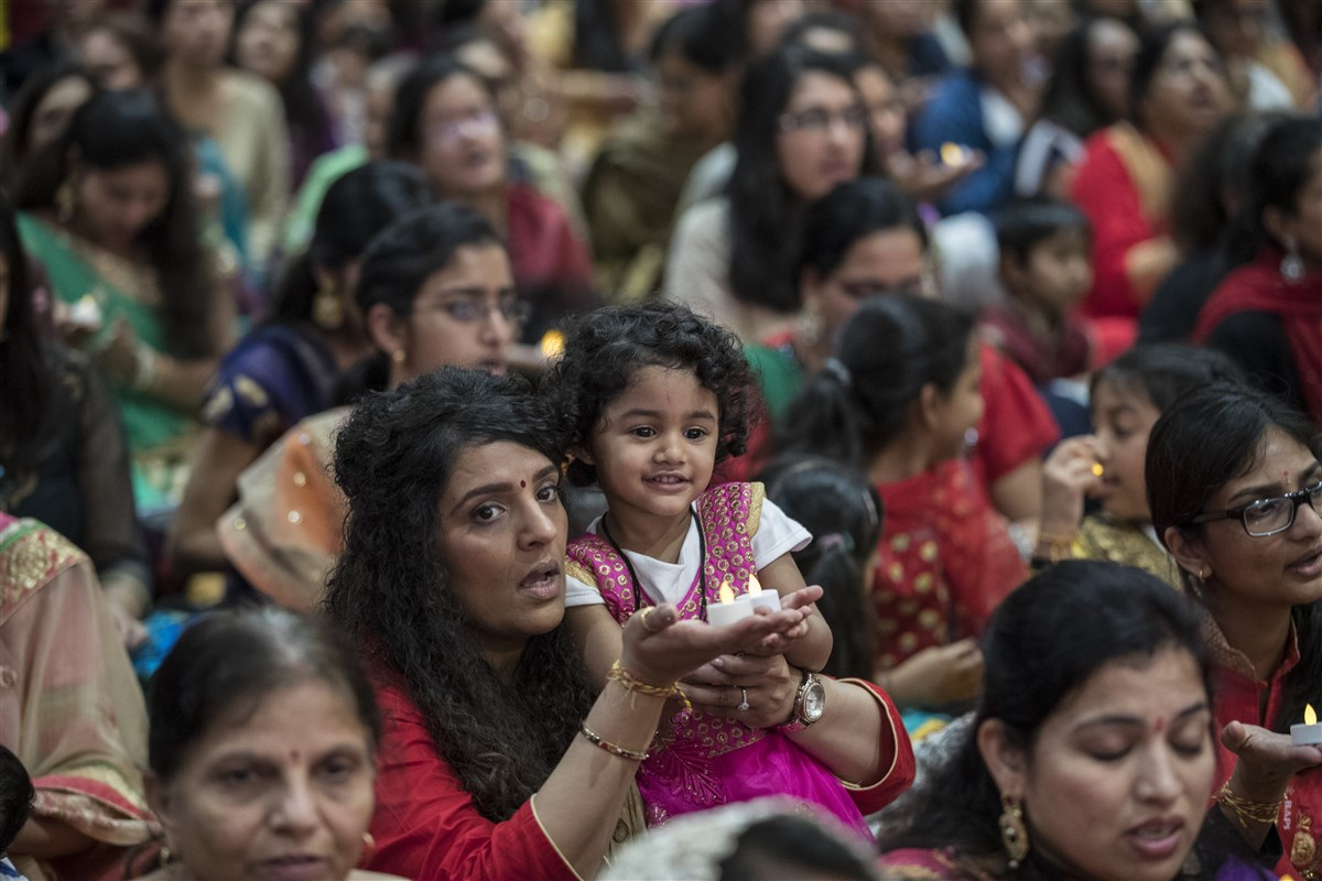 Devotees participate in the chopda pujan ceremony