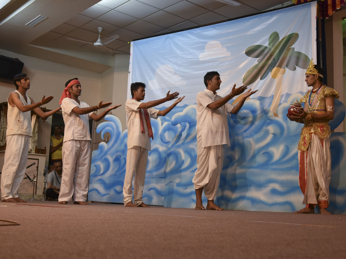 Youths perform a skit in the evening 'Gramya Din' assembly