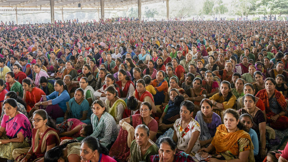 Devotees listen to the discourses