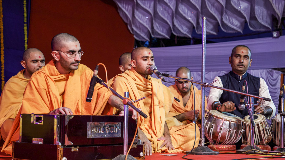 Sadhus sing kirtans in the welcome assembly