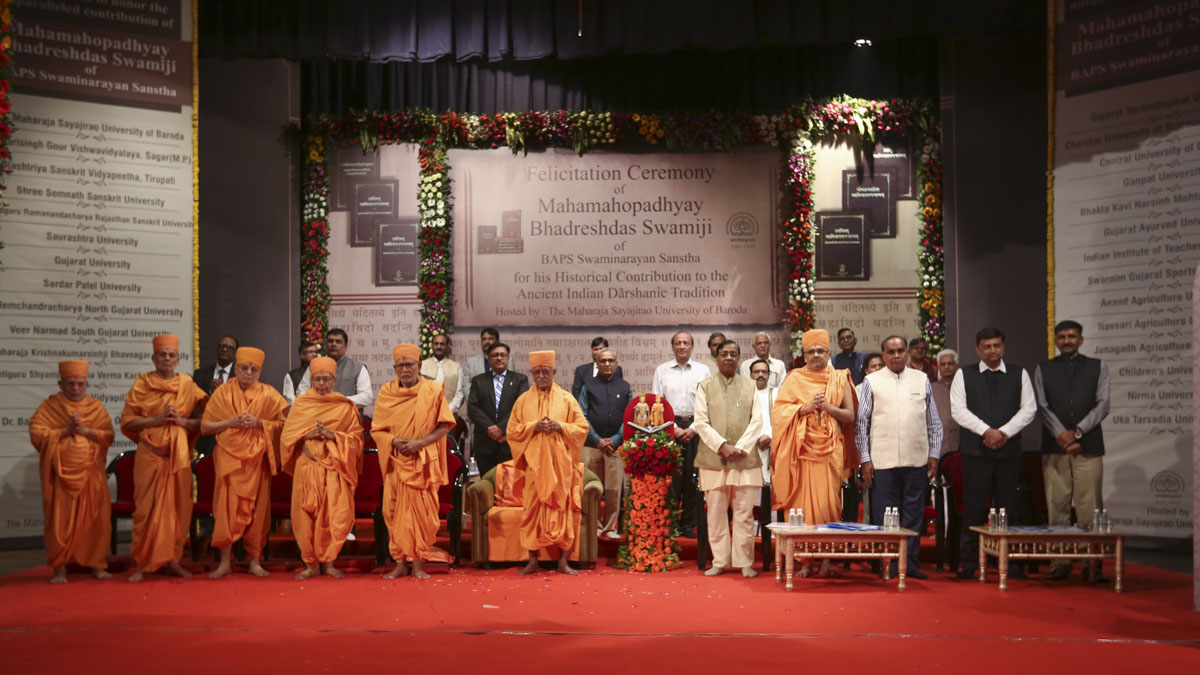 Senior sadhus, vice chancellors and university representatives on stage