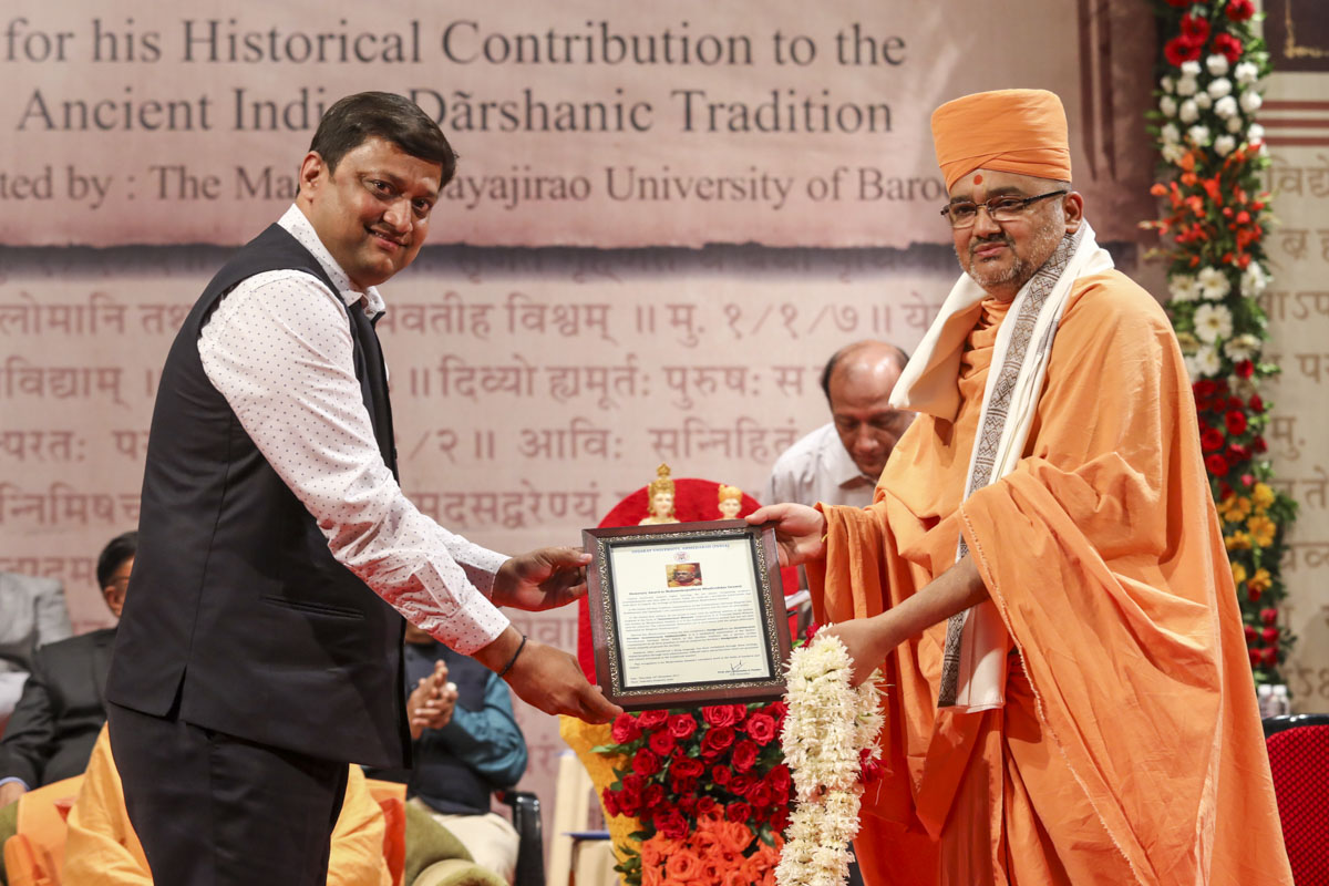 Vice Chancellor Dr. H.A. Pandya of Gujarat University, honors Bhadresh Swami