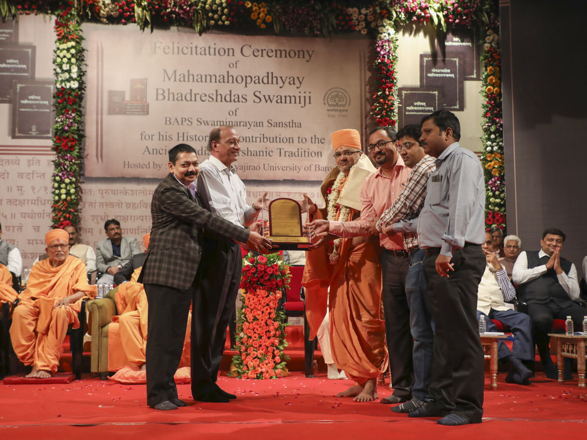 Vice Chancellor Dr. Pankaj Jani and representatives of Dr. Babasaheb Ambedkar Open University, honor Bhadresh Swami