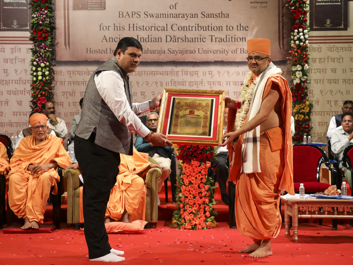Vice Chancellor Dr. Mahendra Sharma of Ganpat University honors Bhadresh Swami