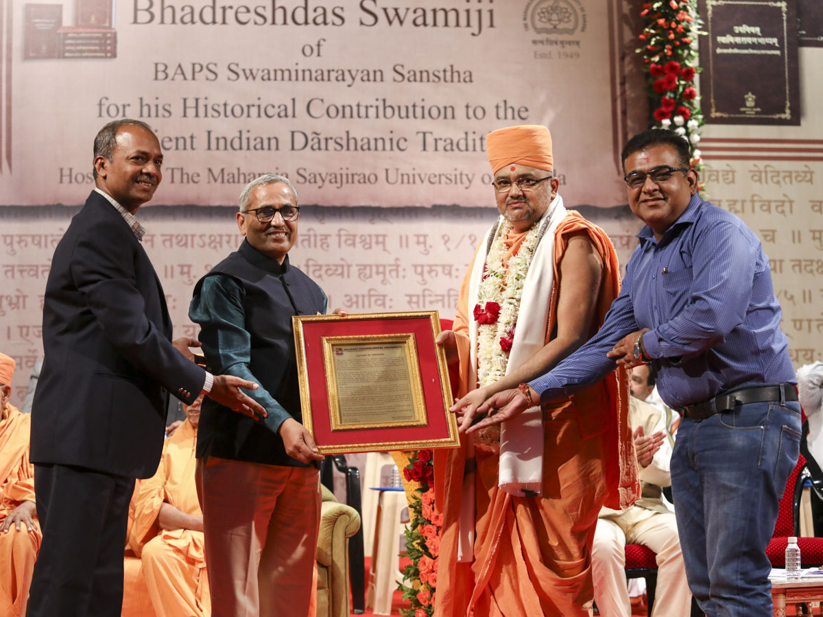 Vice Chancellor Dr. Navinbhai Sheth and representatives of Gujarat Technological University honor Bhadresh Swami