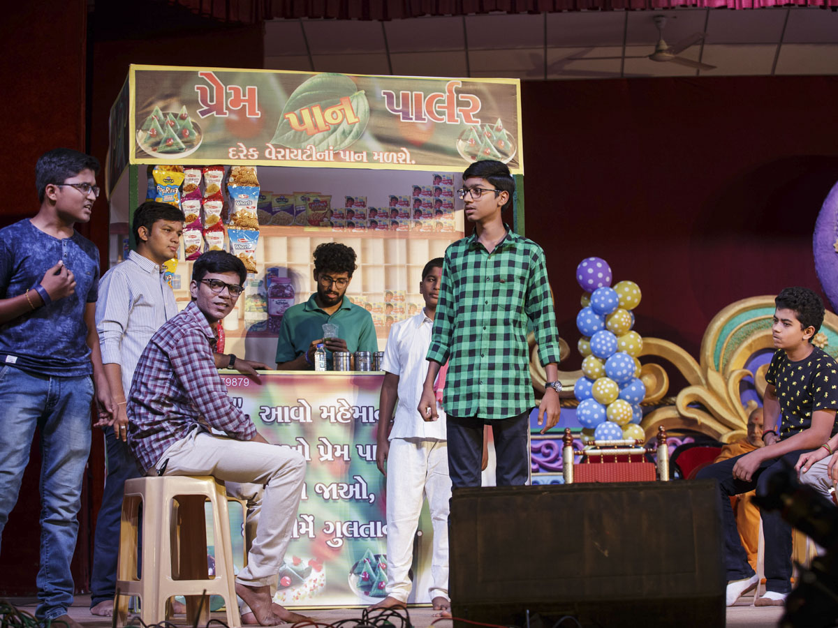 A drama presentation by youths during the evening satsang assembly