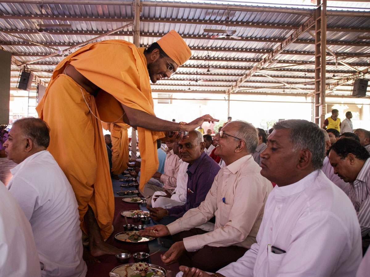 Fathers of the parshads participate in mahapuja rituals