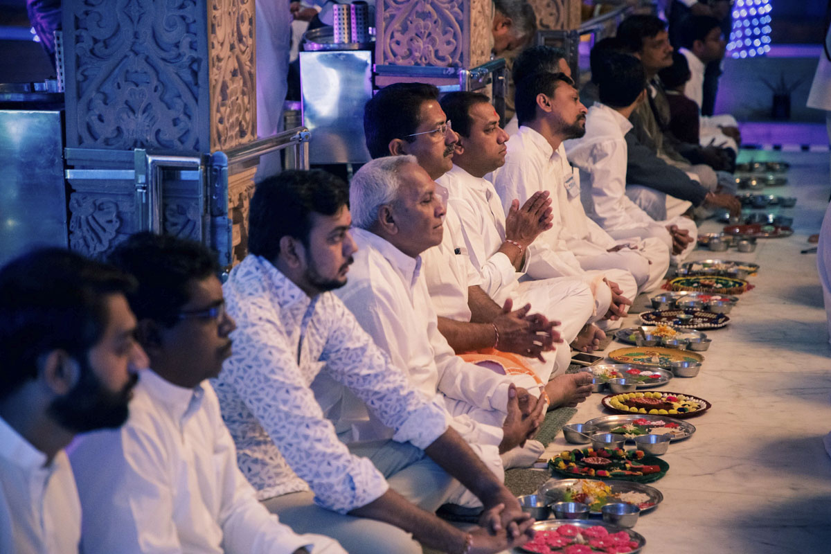 Devotees participate in the mahapuja rituals