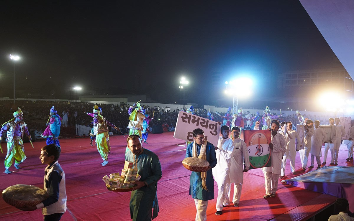 Children and youths present a thematic parade to celebrate the Jholi festival