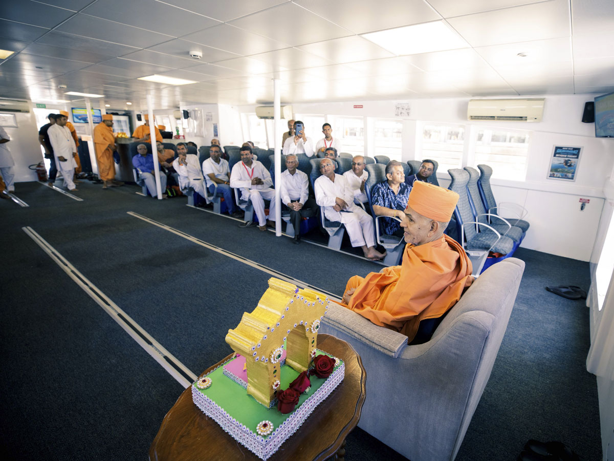 Swamishri and devotees on the boat