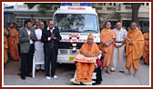 Swamishri sanctifies a new ambulance donated to Pramukh Swami Hospital