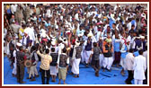 Tribal devotees rejoice by dancing and singing kirtans