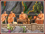 Swamishri and senior sadhus on stage