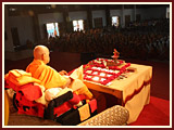Swamishri engaged in his morning puja in the assembly hall