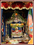 Shri Harikrishna Maharaj in a decorated hindolo