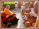 Swamishri by the sacred khijdo tree
