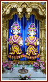 Shri Akshar-Purushottam Maharaj adorned with flowers