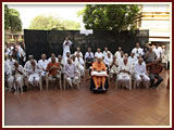 Swamishri with senior devotees