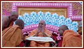 Sadhus honor Swamishri with garlands