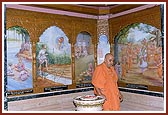 Swamishri performs pradakshina of the birthplace shrine of Gunatitanand Swami