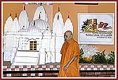 Swamishri walks past the Shila and the Mandir Model