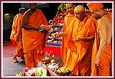 morning ,Swamishri throws flowers on the annakut offering and sanctifies the food items