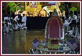 Evening ,Swamishri controls a remote-controlled Rath with Shri Harikrishna Maharaj in it