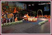 Morning,Saints sing kirtans while Swamishri performs pooja