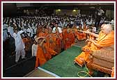 Evening ,Swamishri sprays saints with the sanctified water