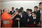 Swamishri blessing students from The Swaminarayan School
