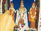 Performing puja of the Lord's murti on Gunatitanand Swami diksha day
