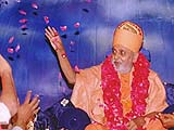 Showering flower petals on children and youths who performed a stage drama on Shastriji Maharaj's life