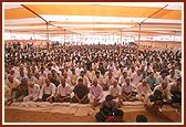 Devotees seated in the murti pratishtha assembly