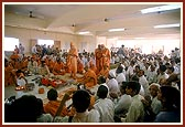 Devotees seated in the mandir hall during the pratishtha ceremony