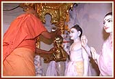 Swamishri performing abhishek (oblations) of the Lord on the first inauguration anniversary of the mandir (Patotsav)